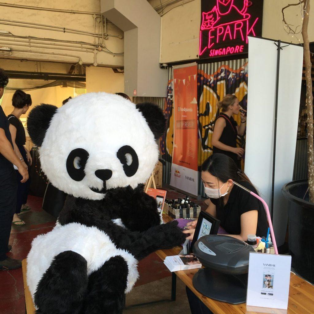 Mascot getting manicure at Foodpanda event